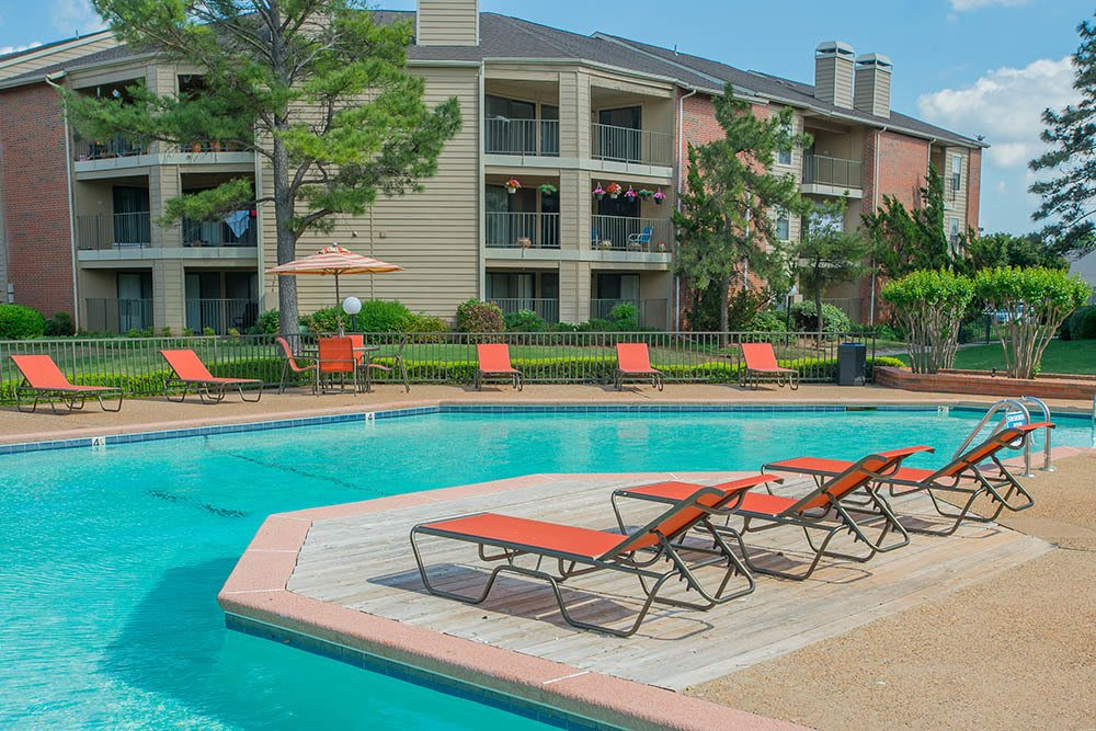 Relax in our poolside sun chairs at Copperfield Apartments