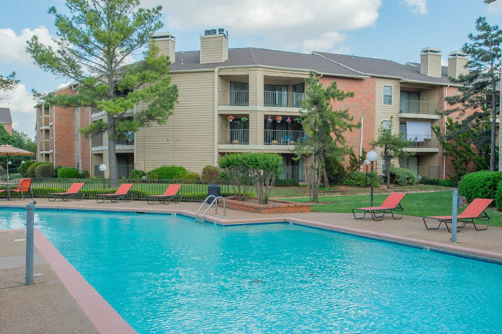 Take a dip in our sparkling pool at Copperfield Apartments
