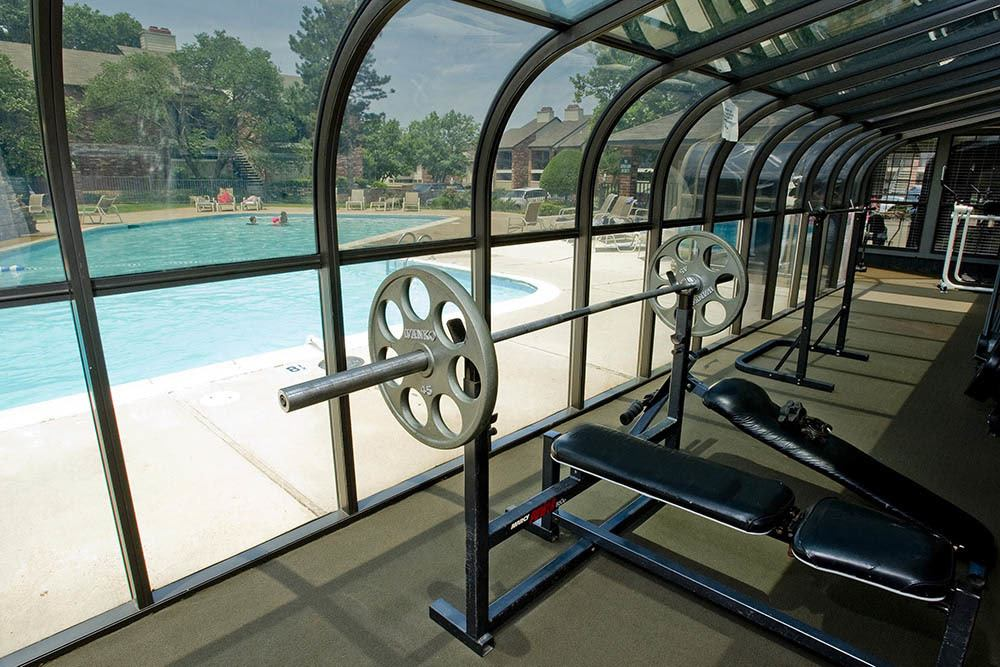 Our fitness center looking out at the pool at Warrington Apartments