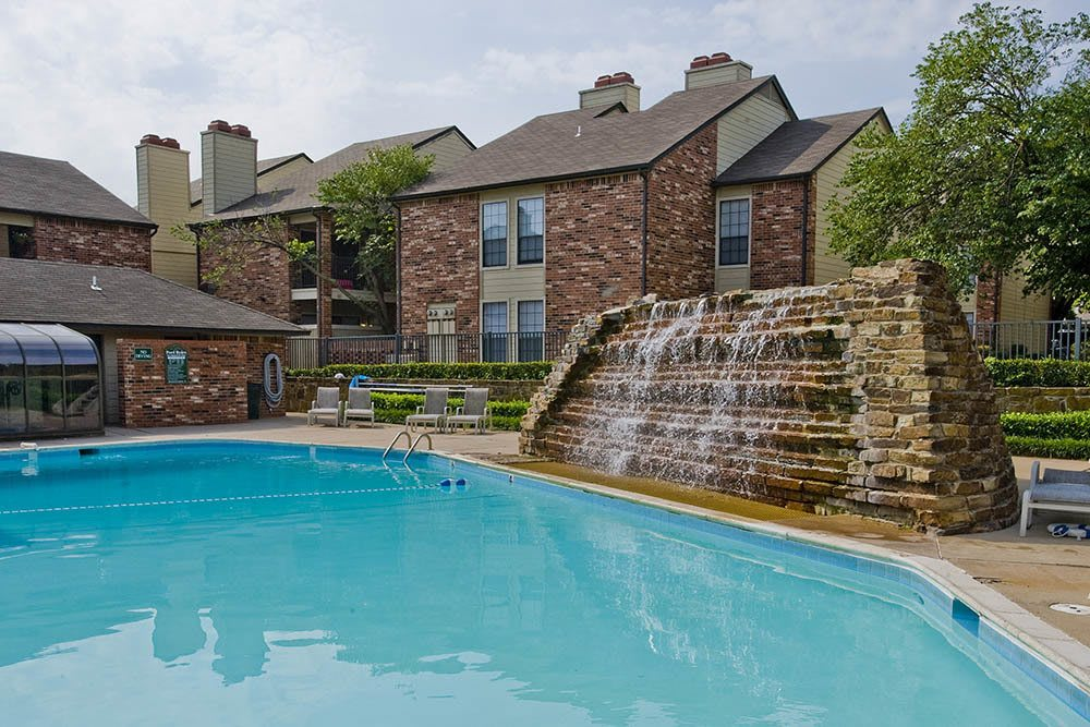 Take a dip in our refreshing pool with a rock waterfall at Warrington Apartments