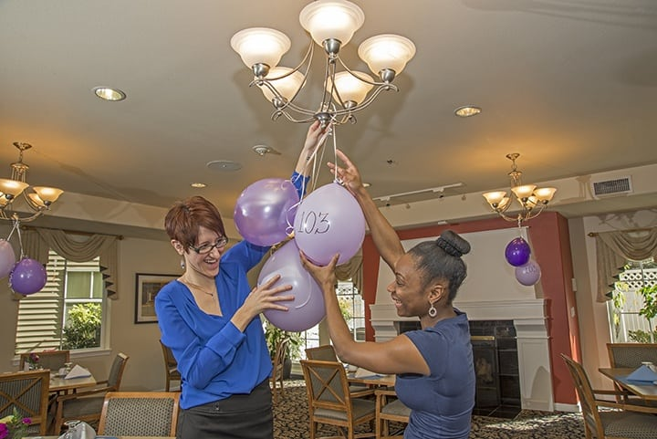 Hanging balloons at the senior living in Renton
