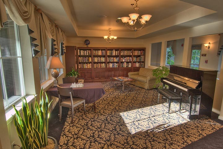 Renton senior living with a large library