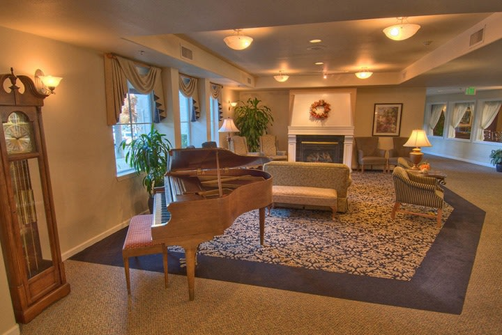 Common room with fireplace at Renton senior living