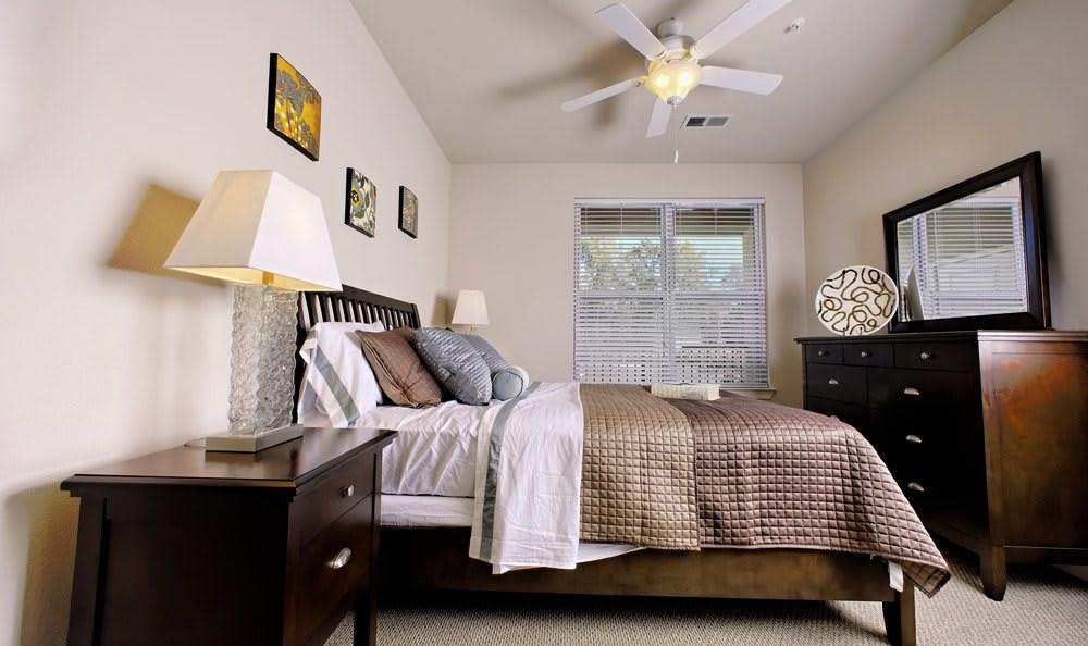 Bedroom with night stand and bed