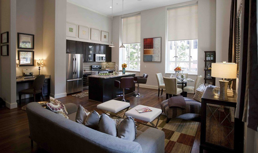Living room, dining room and kitchen view at 400 North Ervay Apartment Homes