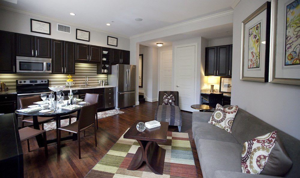 Living room and dining room at 400 North Ervay Apartment Homes in Dallas, TX