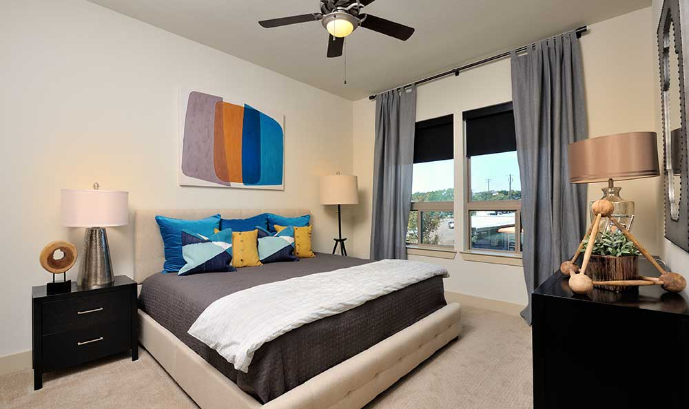 The bedroom is a best place for a relaxing and enjoying a view from your balcony at 422 At The Lake.