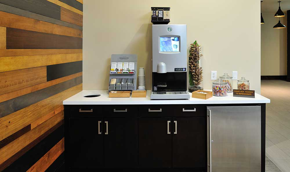 A coffee bar for residents is a popular amenity at 422 At The Lake.