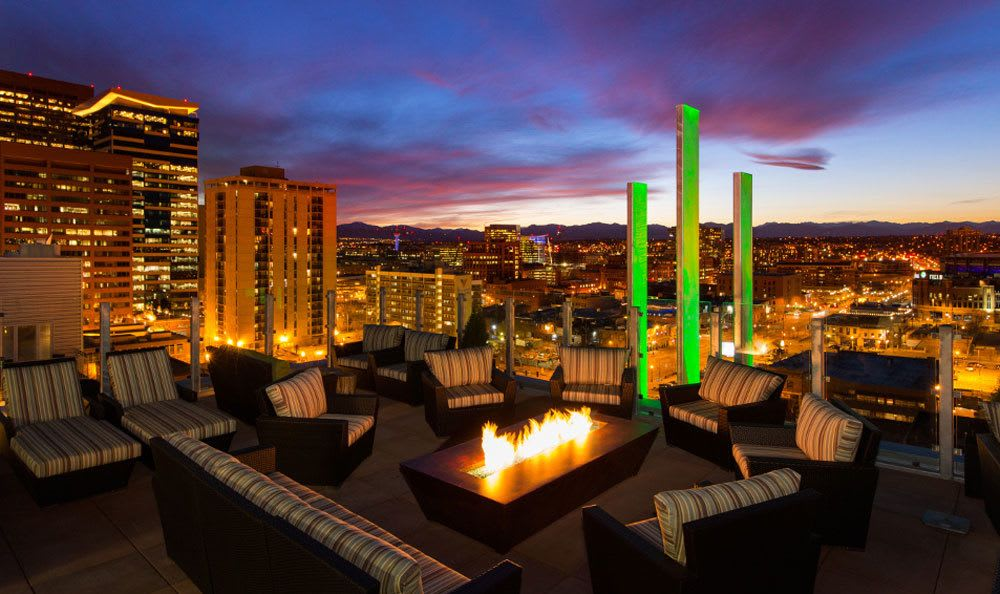 Luxury apartments featuring an outdoor fireplace