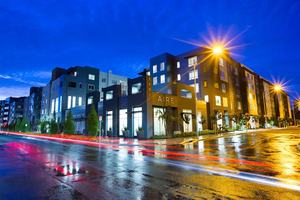 Exterior view of San Jose apartments at night