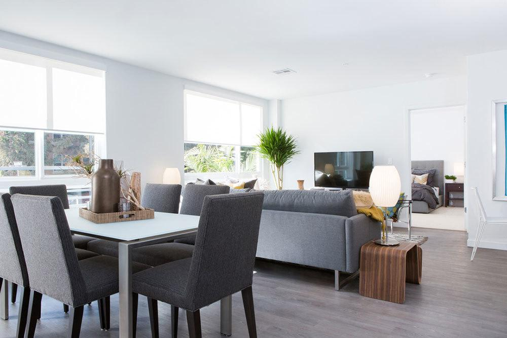 Modern furnishings and wood-style flooring at Aire