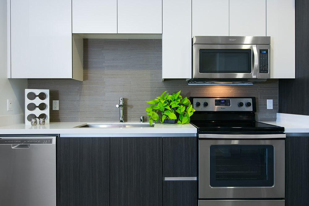 Aire kitchen features modern appliances and finishes