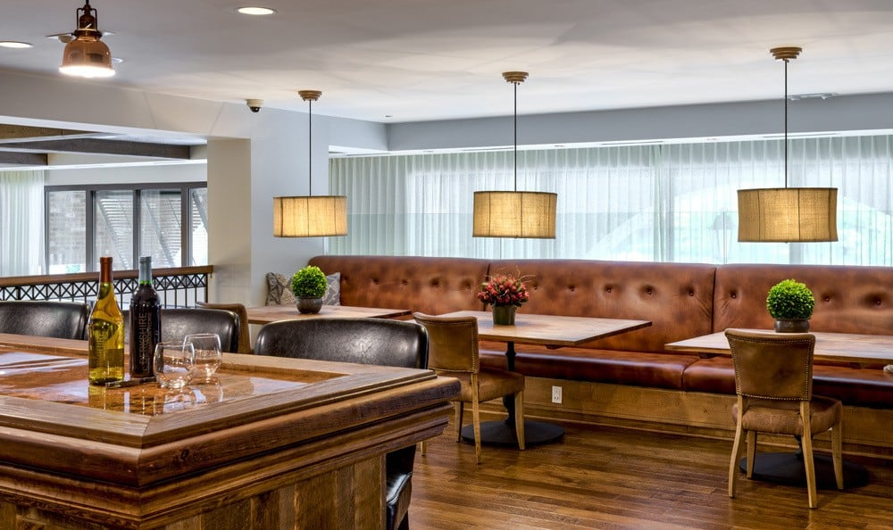 Tables and bar at apartments in Raleigh