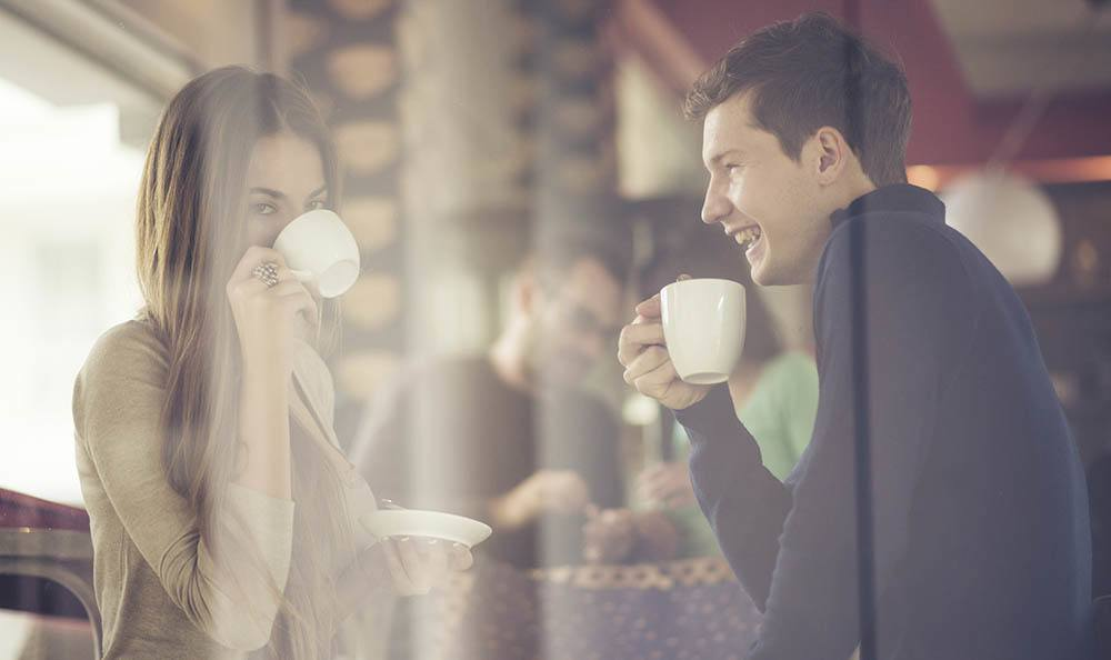 Happy couple enjoying coffee