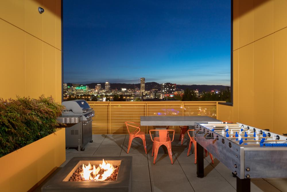 Our apartment community offers residents a sky lounge with BBQ and Playground