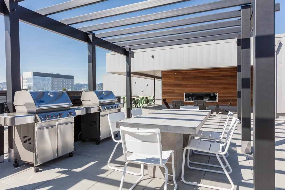 Rooftop Deck with BBQ Stations and Fire Pits at Portland apartments