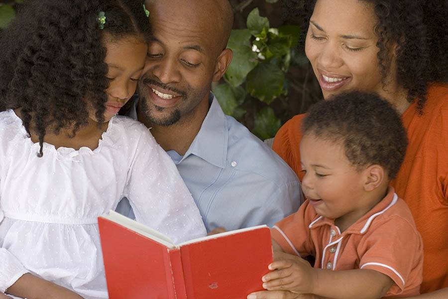 Family reading together at Berkshire Dilworth