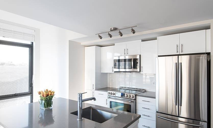 Beautiful white kitchen with great views of Washington, DC