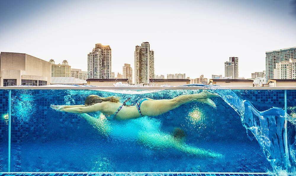 Woman Swimming At The Benjamin Seaport Residences