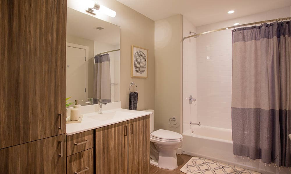 Bathroom with wood cabinets at VIA