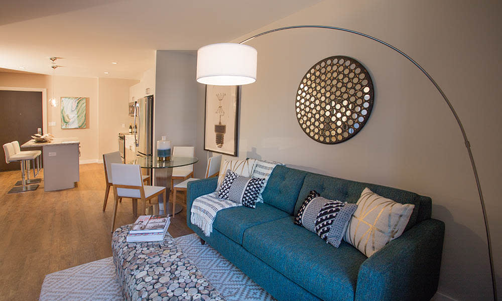 Model living room at VIA Seaport Residences in Boston, MA