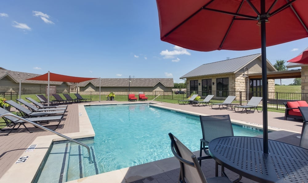 Swimming pool area at our apartments in Richardson