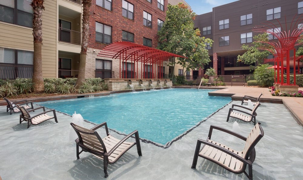 Poolside amenities at our apartments in Houston