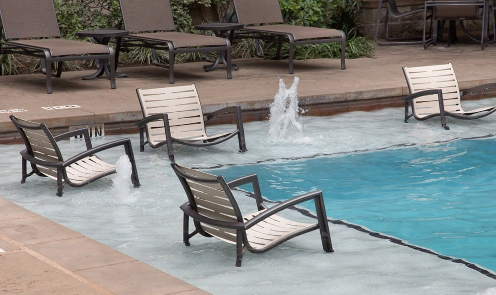 Poolside seating at our Houston, TX apartments