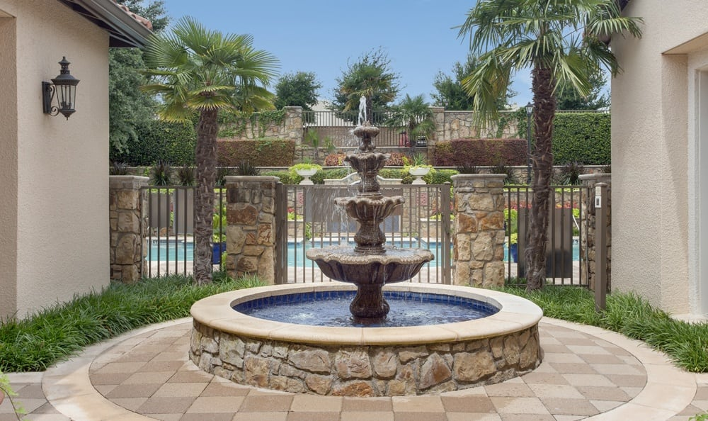 Fountain at the entrance of Estancia Townhomes