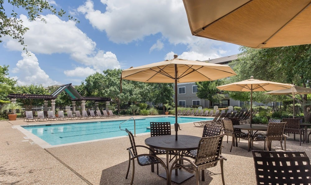 Poolside tables at our Austin, TX apartments