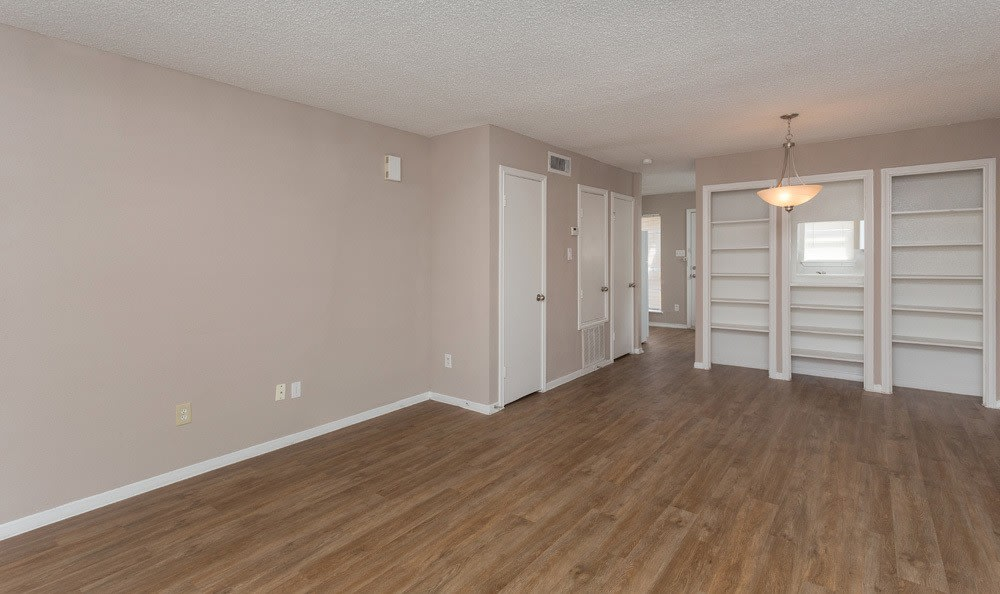 Spacious room with hardwood floors in our Houston apartments