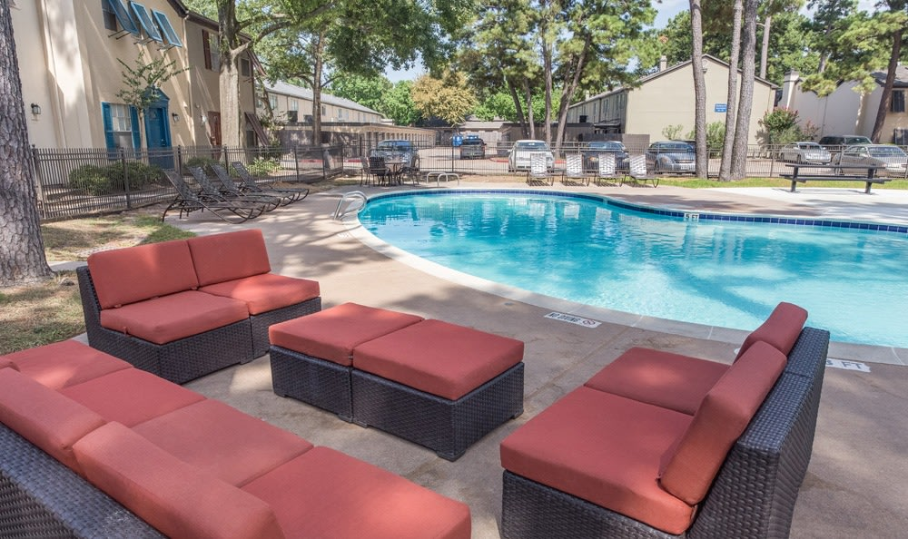 Comfortable outdoor seating by our pool at our Houston apartments