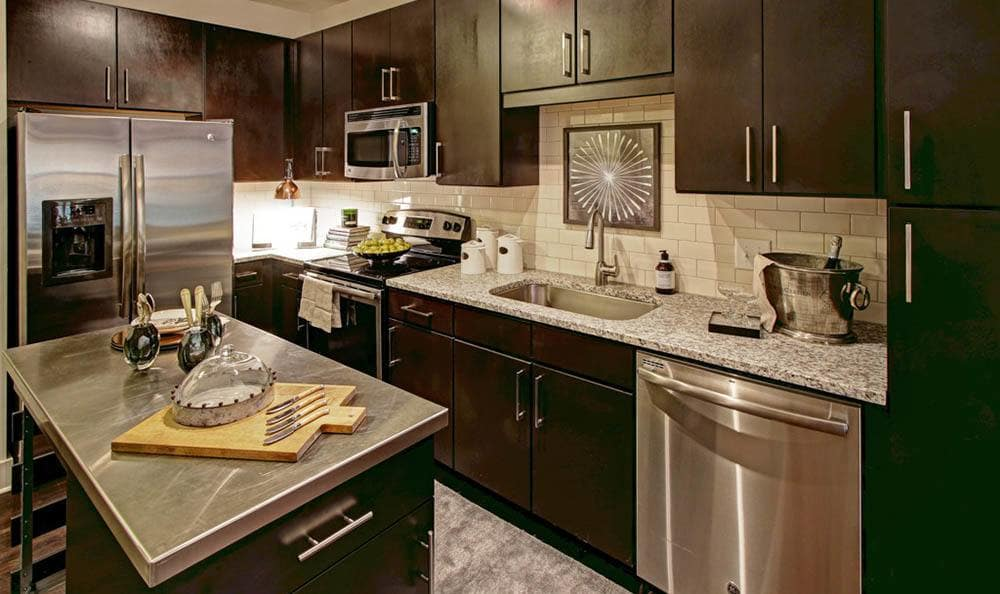 Kitchens come complete with granite countertops and custom fixtures
