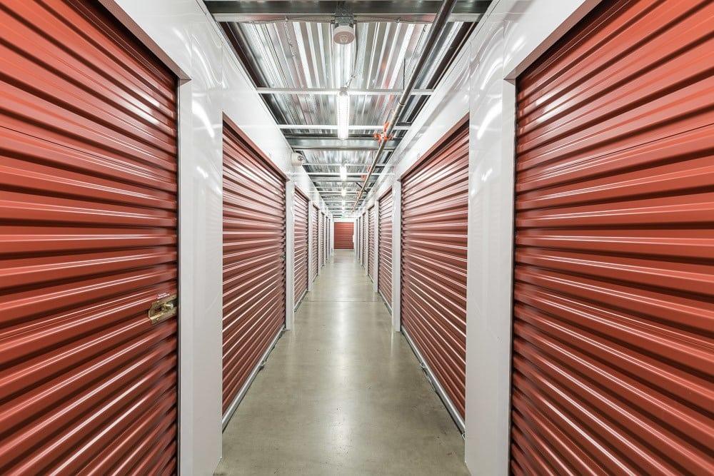 Many self storage units line a hall in Portland, OR