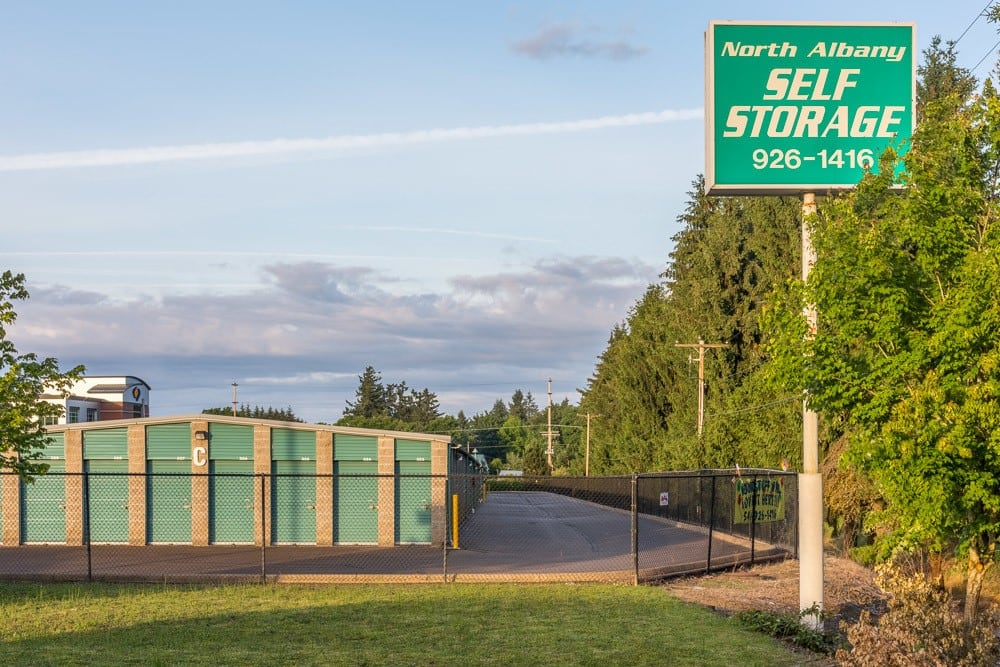 Exterior sign pointing you towards self storage in Albany, OR.