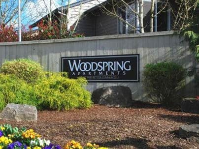 Woodspring Apartments entrance sign
