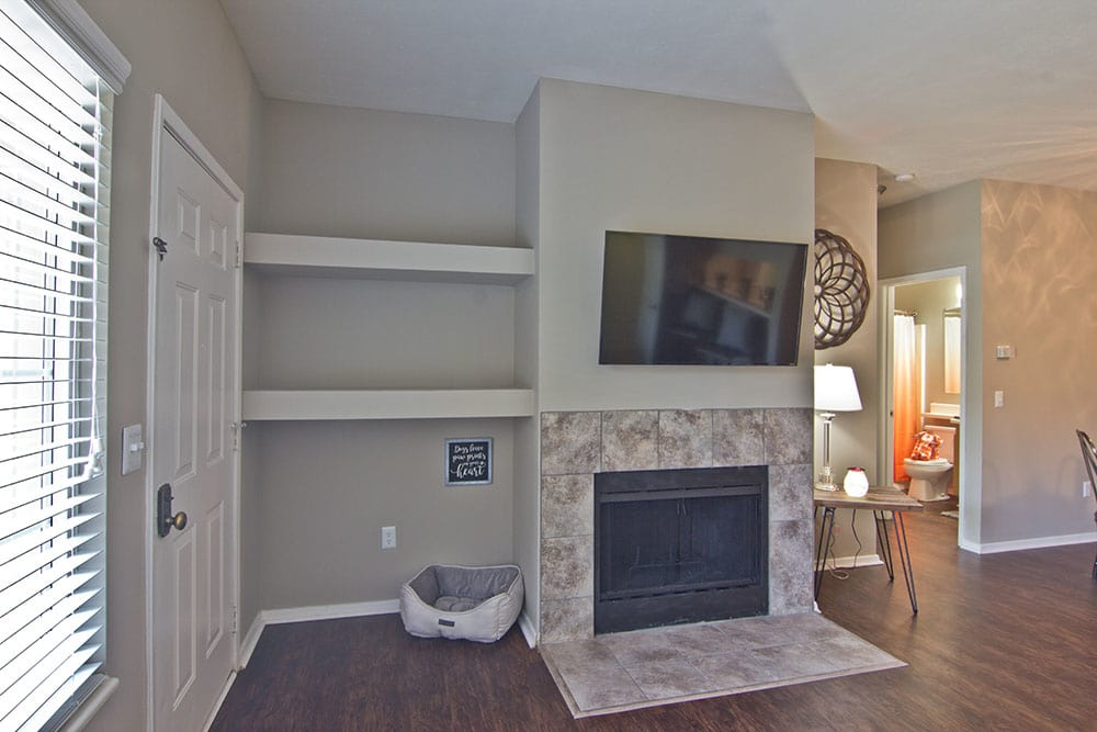 Spacious living room with fireplace at apartments in Perrysburg, Ohio