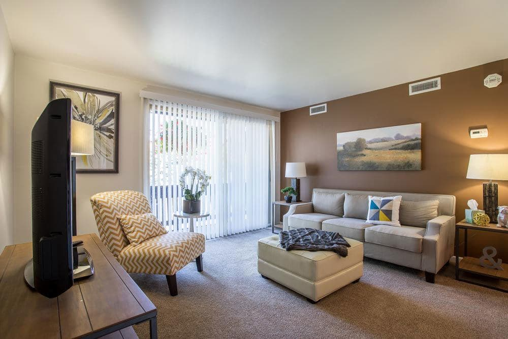 Cheektowaga apartments includes living rooms with attached patios