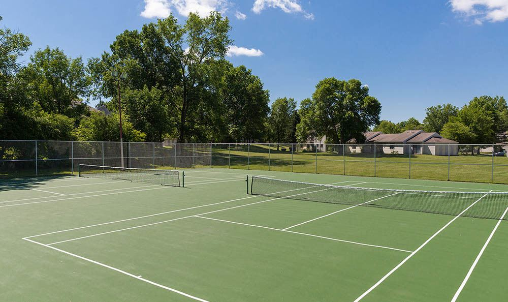 Practice your serve on the tennis courts at Penbrooke Meadows Apartments in Penfield
