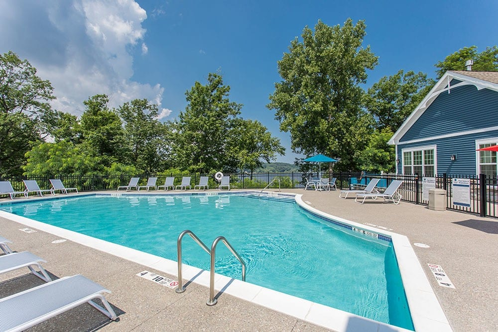 A sparkling pool is just one of the many amenities that Waters Edge Apartments has to offer.