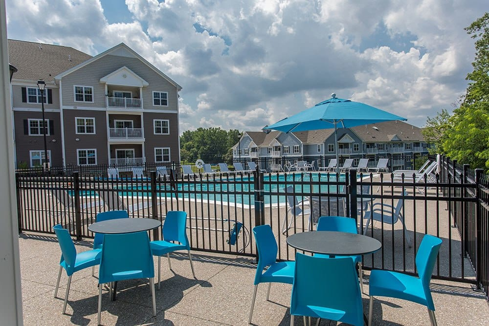 Outdoor furniture near pool at Waters Edge Apartments