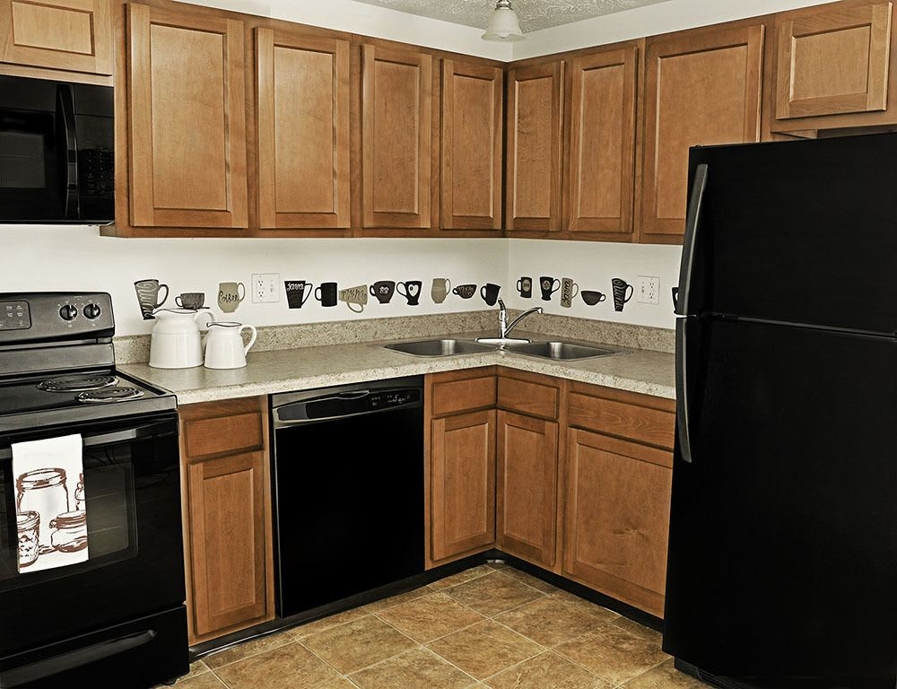 kitchen with black appliances at Webster Manor Apartmentsin Webster NY
