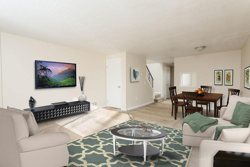 Willowbrooke Apartments and Townhomes offers a Luxury living room in Brockport, New York