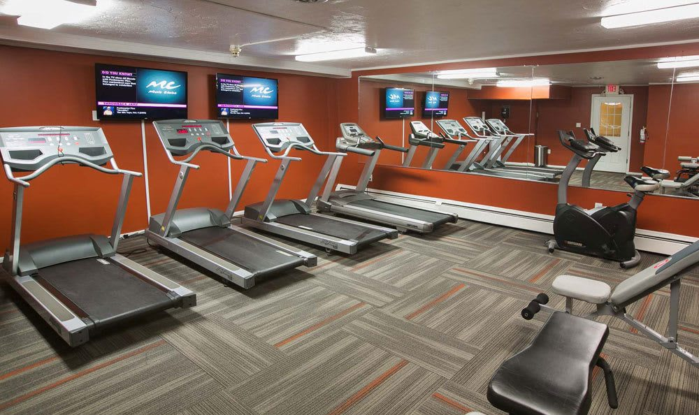 A fitness center is just one of the many amenities that Solon Club Apartments has to offer