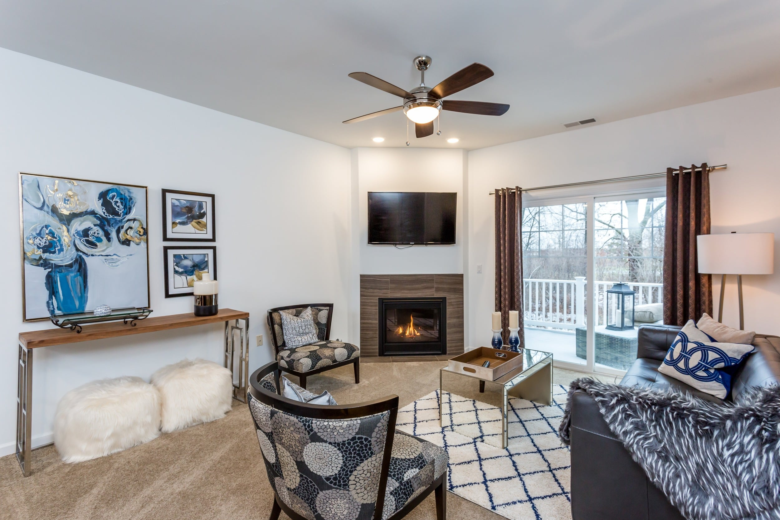 Living room with a cozy fireplace at The Links at CenterPointe Townhomes in Canandaigua, NY
