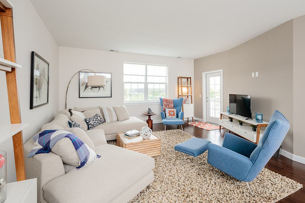 Bright livingroom at Pinnacle North Apartments in Canandaigua, NY