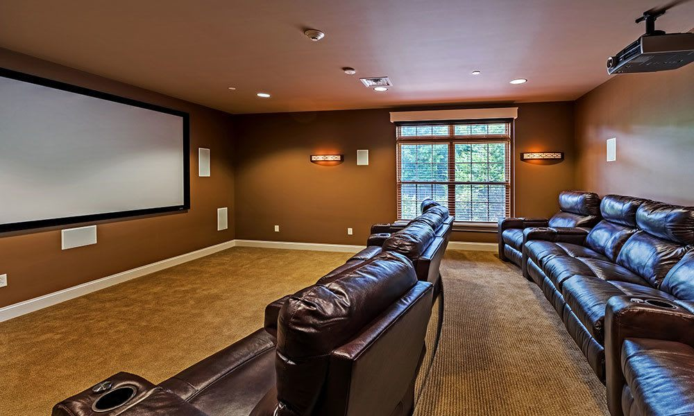 A theater room is just one of the many amenities that Reserve at Southpointe has to offer