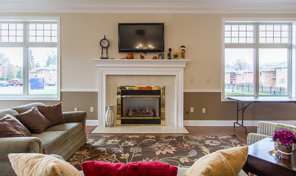 Seating and a cozy fireplace at Knollwood Manor Apartments in Fairport, NY