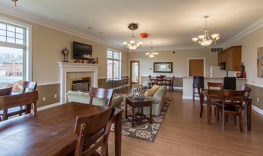 Knollwood Manor Apartments's beautiful clubhouse interior with seating and a fireplace