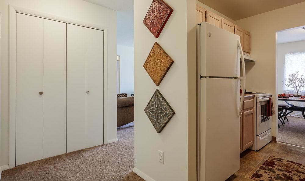 Kitchen and hallway with storage at Brookwood on the Green in Liverpool, NY